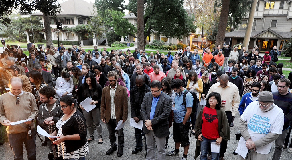 Description of . Participants at Fuller pray before a March to Pasadena City Hall. Fuller Seminary held a march Monday, February 18, 2013, with an estimated 125 people from Fuller Seminary's campus walking to Pasadena City Hall as part of an evangelical community call for immigration reform. The new president Mark Labberton and associate provost Juan Martinez  participated Students song hymns and held signs as they walk on Colorado Boulevard to Pasadena City Hall.(Photo by Walt Mancini/Pasadena Star-News)