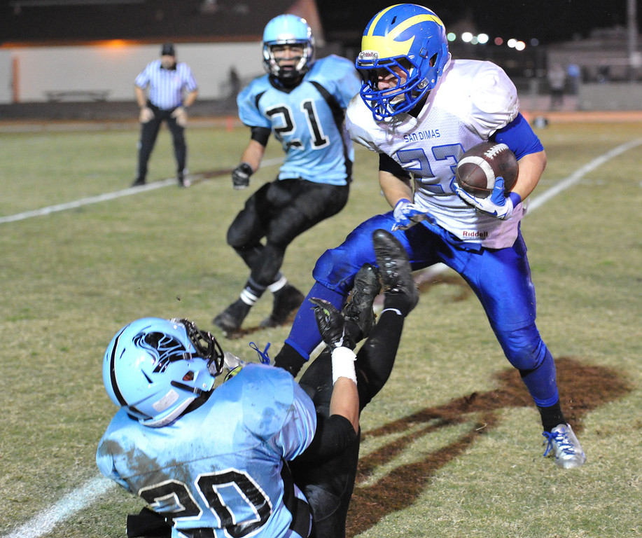 Description of . San Dimas running back Joseph Mayorga (#23) runs for a touchdown as they pLay Arroyo in their CIF Semi-Final football game at Arroyo High School in El Monte on Friday November 29, 2013. (San gabriel Valley Tribune/Staff Photo by Keith Durflinger)