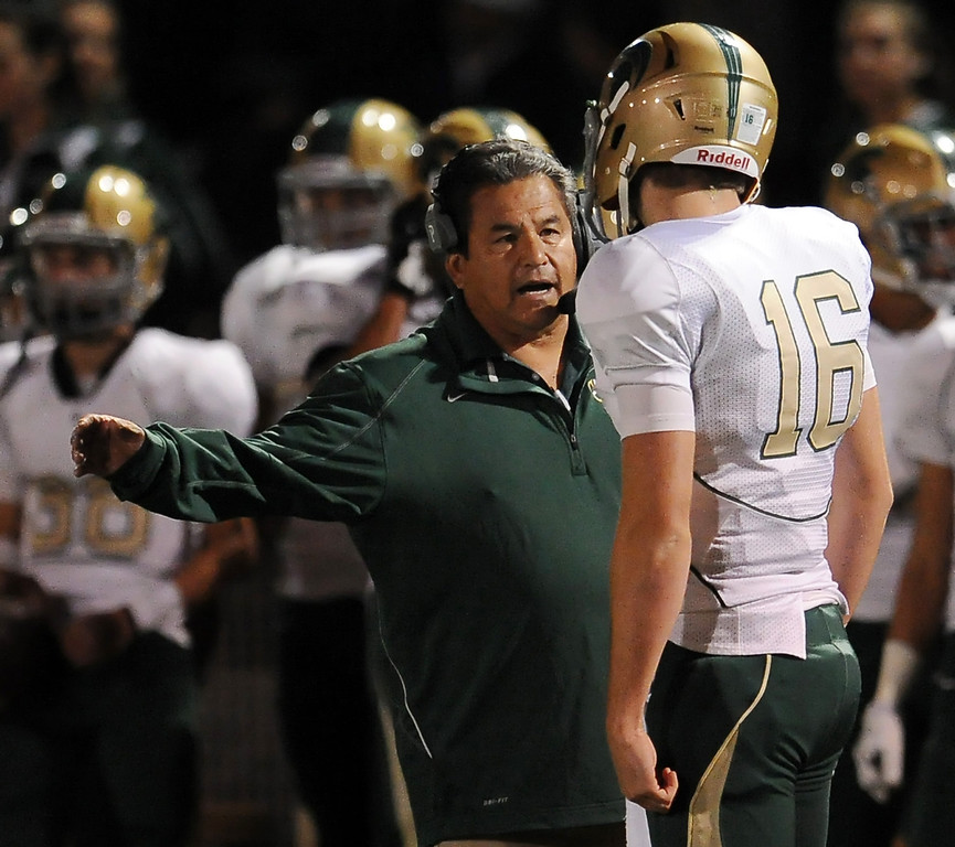 Description of . Damien head coach Mark Paredes talks with his quarterback Brendan Callen (16) in the first half of a prep football game against St. Francis at St. Francis High School in La Canada, Calif., Friday, Sept. 27, 2013.   (Keith Birmingham Pasadena Star-News)