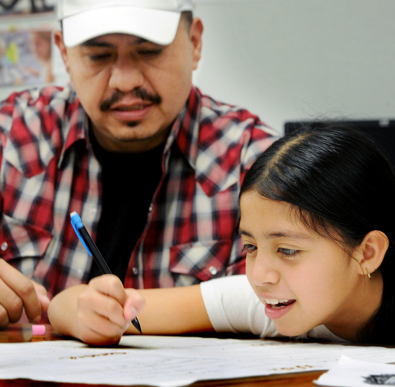 Description of . Manuel Davila, helping his daughter Ana Davila with lesson at Elwin Elementary School in Baldwin Park host,