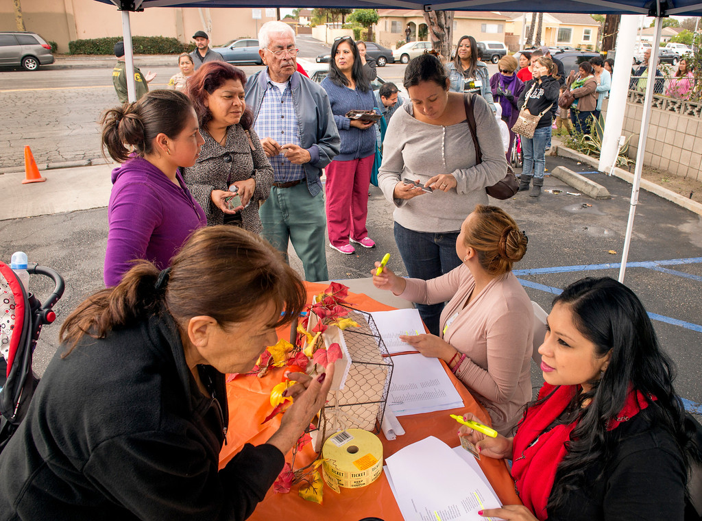 Description of . El Rancho Vista Healthcare Center workers pass out Thanksgiving turkeys to 200 needy families at the Pico Rivera, Calif. facility on Mines Avenue Nov. 21, 2013.  (Staff photo by Leo Jarzomb/Whittier Daily News)