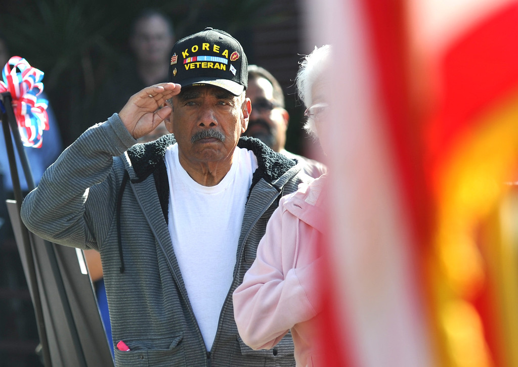 Description of . Veterans salute as the national anthem is performed during the Veterans Day Celebration at El Monte City Hall on Monday November 11, 2013. Veterans are honored with speeches and music and a flag ceremony. (San Gabriel Valley Tribune/Staff Photo by Keith Durflinger)