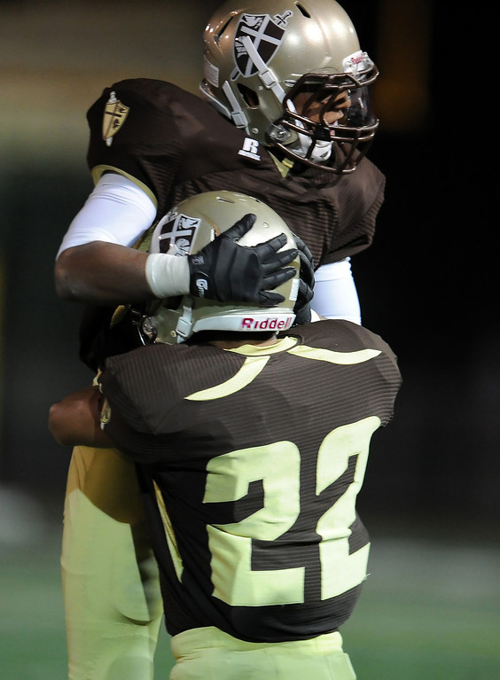 Description of . St. Francis' Mason Williams jumps into his teammate Areg Nazarian (22) arms after recovering a Damien fumble in the first half of a prep football game at St. Francis High School in La Canada, Calif., Friday, Sept. 27, 2013.   (Keith Birmingham Pasadena Star-News)