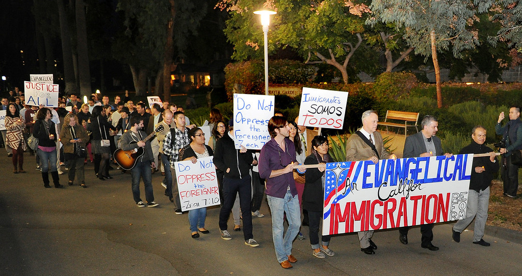 Description of . Fuller Seminary held a march Monday, February 18, 2013, with an estimated 125 people from Fuller Seminary's campus walking to Pasadena City Hall as part of an evangelical community call for immigration reform. The new president Mark Labberton and associate provost Juan Martinez  participated Students song hymns and held signs as they walk on Colorado Boulevard to Pasadena City Hall.(Photo by Walt Mancini/Pasadena Star-News)