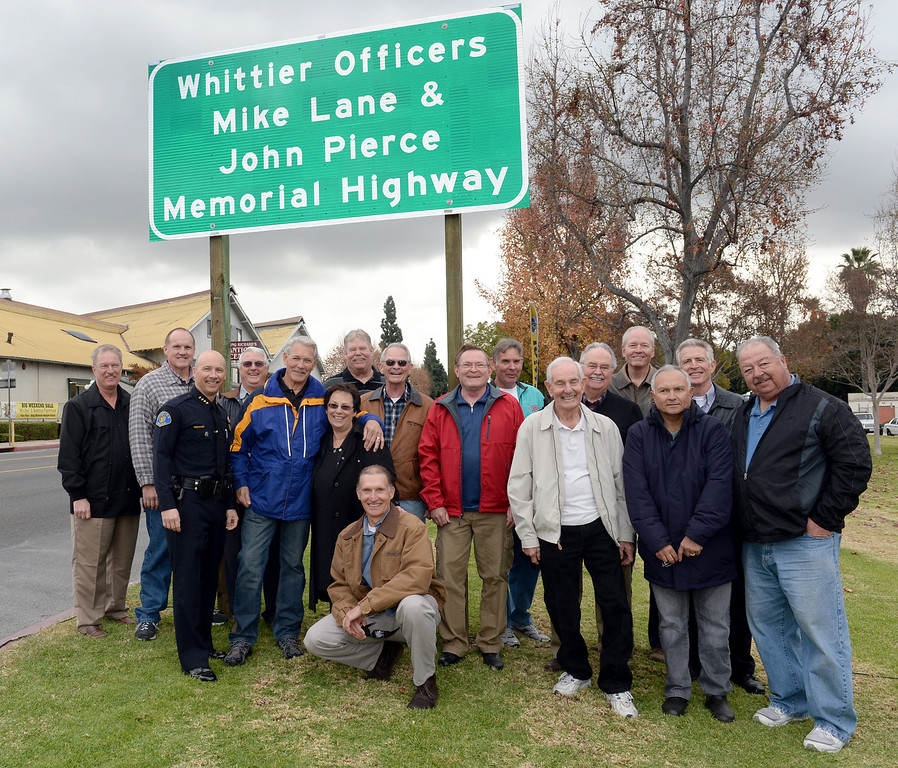 Description of . Whittier Police Chief Jeff Piper stands with retired officers in front the Whittier Officers Memorial Highway on Whittier boulevard at Penn Street on Thursday December 19, 2013. A portion of State Route 72 from the western entrance at the intersection of Penn Street and Whittier Boulevard to the eastern entrance of State Route 72 at the intersection of Costa Glen Avenue and Whittier Boulevard as the Whittier Officers Mike Lane and John Pierce Memorial Highway. (Photo by Keith Durflinger/Whittier Daily News)