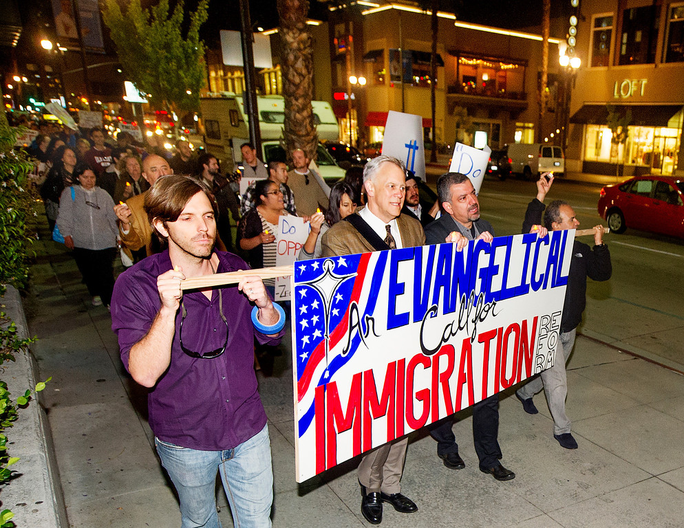 Description of . Paul Weaver, Mark Labberton, new Fuller President, Juan Marinez, Vice Provost and Rev. Rene Molina carrying EVANGELICAL CALL FOR IMMIGRATION REFORM banner.Fuller Seminary held a march Monday, February 18, 2013, with an estimated 125 people from Fuller Seminary's campus walking to Pasadena City Hall as part of an evangelical community call for immigration reform. The new president Mark Labberton and associate provost Juan Martinez  participated Students song hymns and held signs as they walk on Colorado Boulevard to Pasadena City Hall.(Photo by Walt Mancini/Pasadena Star-News)