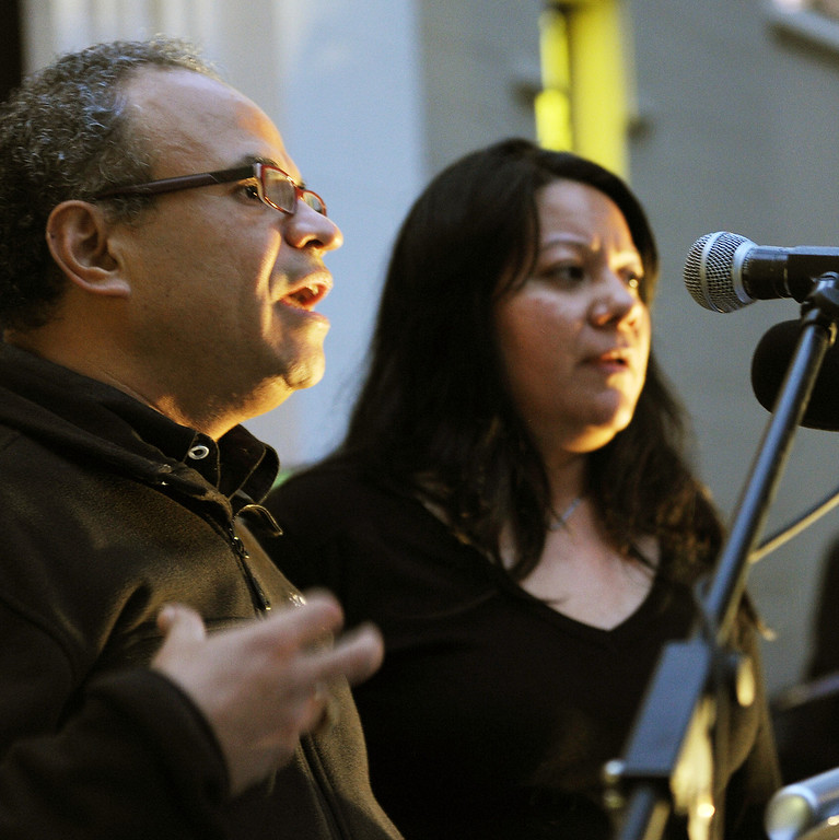 Description of . Rev. Rene Molina speaking to students and faculty with interpreter Veronica Castaneda  before March to Pasadena City Hall. Fuller Seminary held a march Monday, February 18, 2013, with an estimated 125 people from Fuller Seminary's campus walking to Pasadena City Hall as part of an evangelical community call for immigration reform. The new president Mark Labberton and associate provost Juan Martinez  participated Students song hymns and held signs as they walk on Colorado Boulevard to Pasadena City Hall.(Photo by Walt Mancini/Pasadena Star-News)