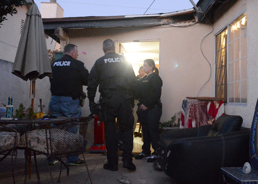 Description of . Whittier Police officers with a task force from area agencies carry out compliance checks on local parolees and probationers on Friday morning December 13, 2013. Officers from the multi-agency task force visited 21 homes during the operation. (Staff Photo by Keith Durflinger/San Gabriel Valley Tribune)