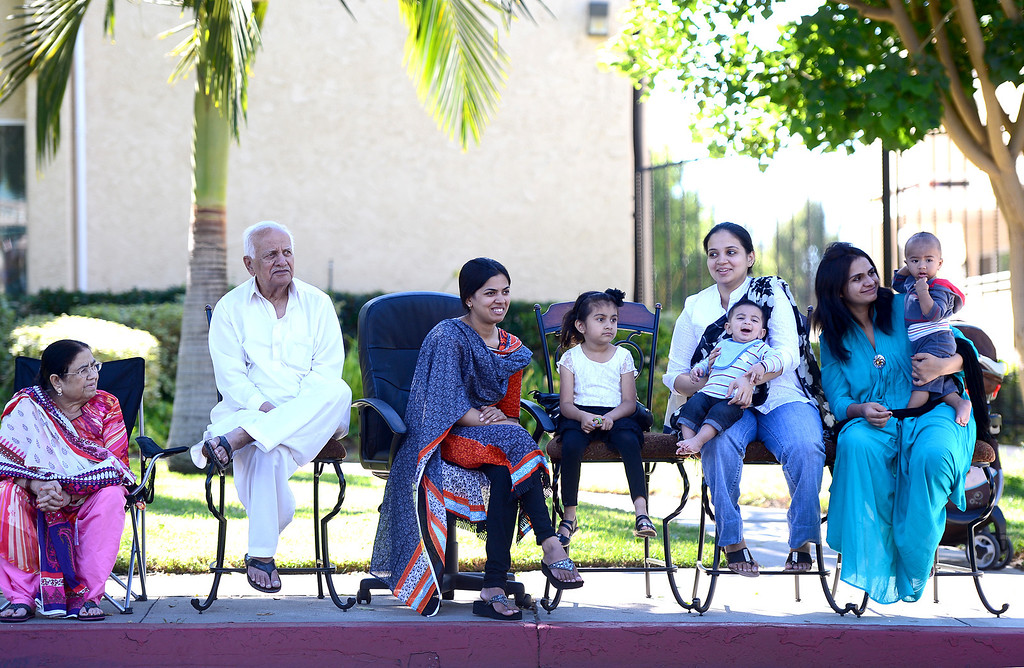 Description of . The Hussain Family watches City of Duarte's annual Route 66 Parade in front of their home along Huntington Drive, on Saturday, September 28, 2013. (Photo by Sarah Reingewirtz/Pasadena Star-News)