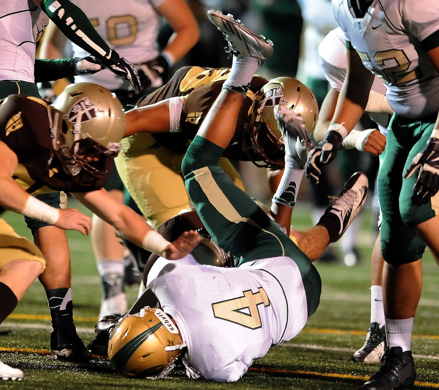 Description of . Damien's Leroy Cloud (4) is upended by the St. Francis defense in the first half of a prep football game at St. Francis High School in La Canada, Calif., Friday, Sept. 27, 2013.   (Keith Birmingham Pasadena Star-News)