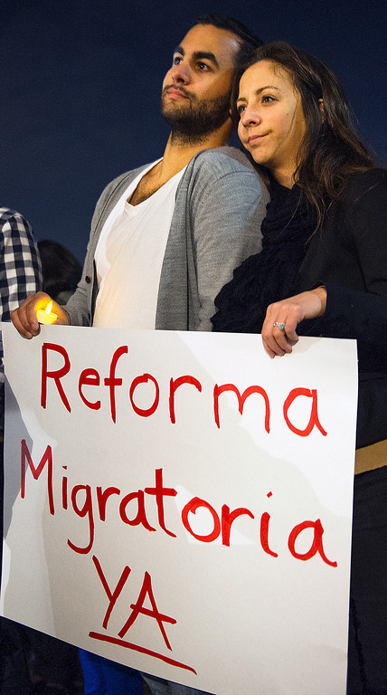 Description of . Paul and Angela Gorrell, both Fuller students listening to Jennifer Hernandez speaking on how she came to USA from Mexico. Fuller Seminary held a march Monday, February 18, 2013, with an estimated 125 people from Fuller Seminary's campus walking to Pasadena City Hall as part of an evangelical community call for immigration reform. The new president Mark Labberton and associate provost Juan Martinez  participated Students song hymns and held signs as they walk on Colorado Boulevard to Pasadena City Hall.(Photo by Walt Mancini/Pasadena Star-News)