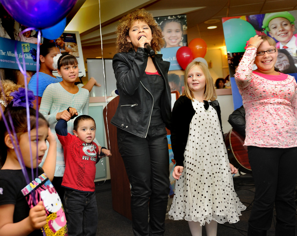 Description of . Rachel Crow, National Adoption Day 2013 Spokesperson, XFactor standout, Columbia Records recoredingt artist, actor and adopted foster child providing entertainment on Adoption Day. On National Adoption Day, hundreds of courts and organizations throughout the nation open their doors to finalize adoptions of children in foster care. Nintey-Five families celebrate with their newly adopted children at the Edmund D. Edelman Children's Court in Monterey Park Friday, November 22, 2013.(Photo by Walt Mancini/Los Angeles Daily News)