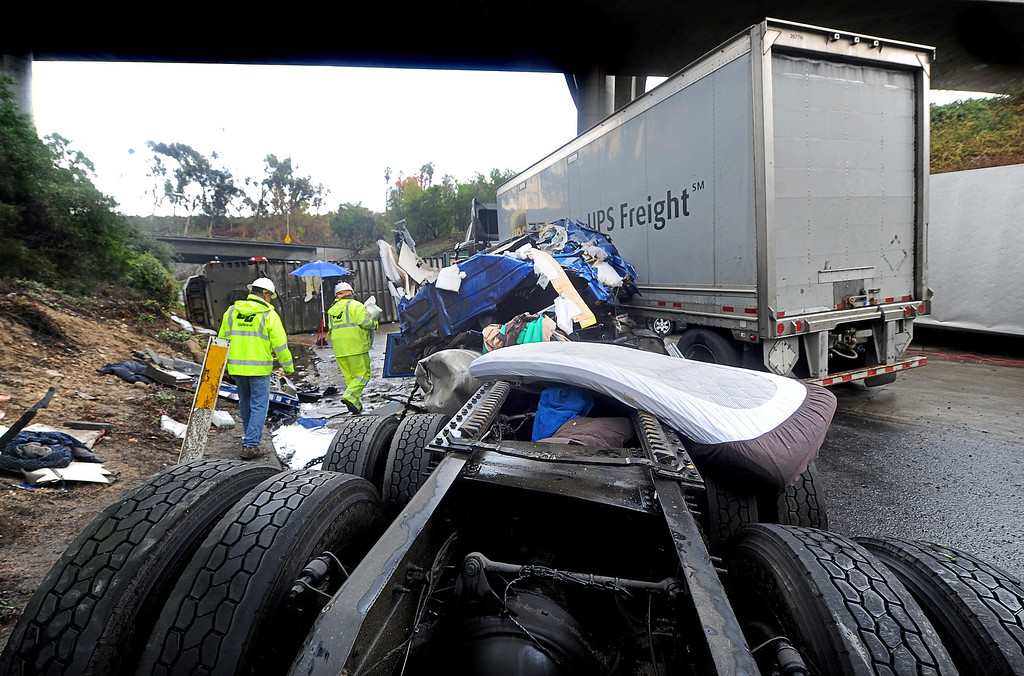Description of . A crash cab where a truck driver was killed. Three big-rig and two cars crashed, killing a truck driver near the runner on (210) Freeway East.  The accident at 12:01 caused the tunnel to be closed and a SigAlert was called where the tunnel was schedule to reopen by 4 to  5 p.m. Thursday, November 21, 2013. (Photo by Walt Mancini/Pasadena Star-News)