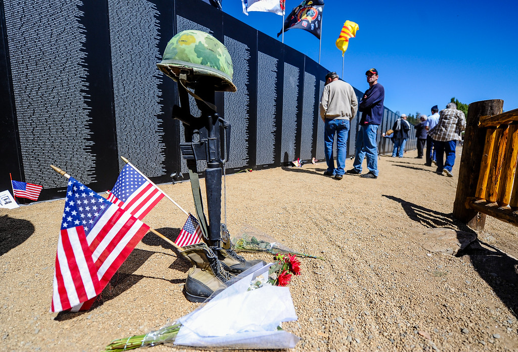 Description of . Local veterans, family and friends of veterans visit the Traveling Vietnam Wall replica memorial at Meadow Park in Big Bear Lake on Friday, Sept. 27, 2013. The wall, presented by the American Veterans Traveling Tribute, is on display for continuous viewing from Sept. 26 through Sept. 28. (Photo by Rachel Luna / San Bernardino Sun)