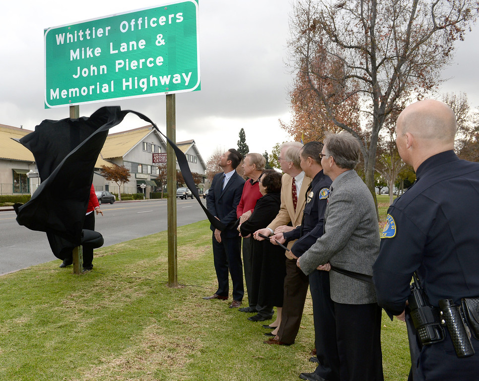 Description of . Assemblymember Ian Calderon joins city and police officials as they unveil the Whittier Officers Memorial Highway on Whittier boulevard at Penn Street on Thursday December 19, 2013. A portion of State Route 72 from the western entrance at the intersection of Penn Street and Whittier Boulevard to the eastern entrance of State Route 72 at the intersection of Costa Glen Avenue and Whittier Boulevard as the Whittier Officers Mike Lane and John Pierce Memorial Highway. (Photo by Keith Durflinger/Whittier Daily News)