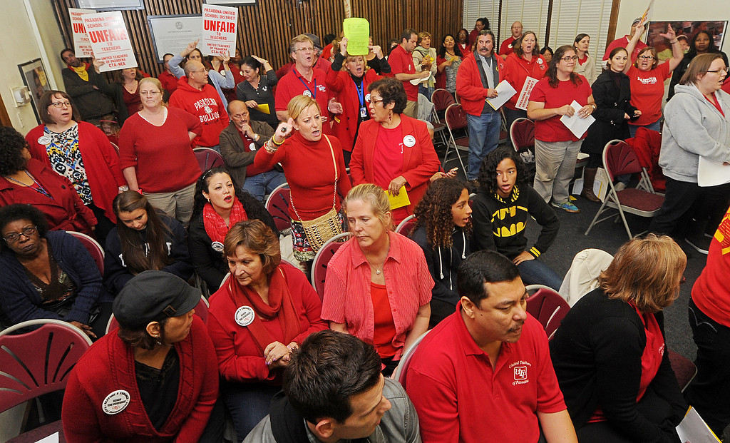 Description of . Over 300 teachers protested in front of PUSD on Del Mar Avenue over the District-Health Care Proposal Thursday, November 21, 2013.  The protest continued inside the building at the school board meeting that was cancelled due to the disturbance.(Photo by Walt Mancini/Pasadena Star-News)