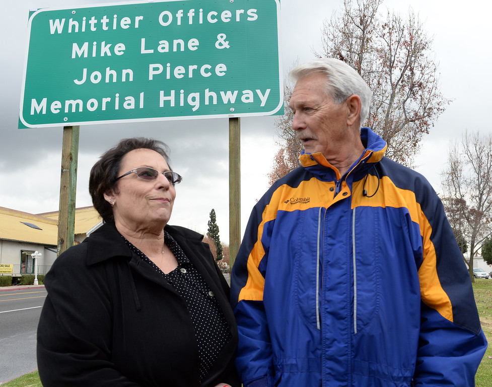 Description of . Former dispatcher and Director of Parks Recreation and Community Services, Fran Shields, and retired officer Mike Willis stand in front the Whittier Officers Memorial Highway on Whittier boulevard at Penn Street on Thursday December 19, 2013. A portion of State Route 72 from the western entrance at the intersection of Penn Street and Whittier Boulevard to the eastern entrance of State Route 72 at the intersection of Costa Glen Avenue and Whittier Boulevard as the Whittier Officers Mike Lane and John Pierce Memorial Highway. (Photo by Keith Durflinger/Whittier Daily News)