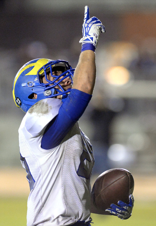 Description of . San Dimas running back Joseph Mayorga (#23) celebrates scoring a touchdown as they pay Arroyo in their CIF Semi-Final football game at Arroyo High School in El Monte on Friday November 29, 2013. (San gabriel Valley Tribune/Staff Photo by Keith Durflinger)