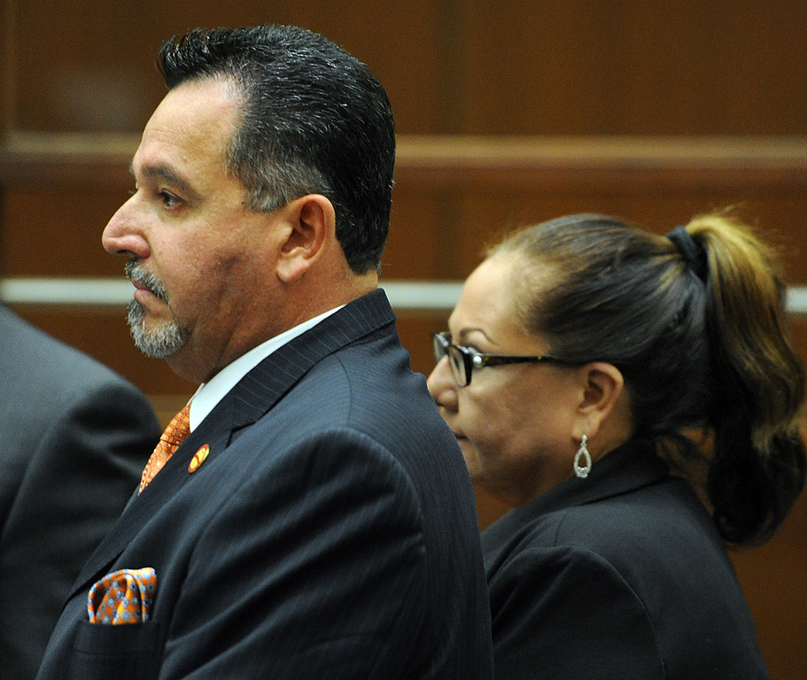 Description of . Council member Mark Breceda, left, and former councilwoman Rosemary Ramirez appeared at Clara Shortridge Foltz Criminal Justice Center in Los Angeles to scheduled a date for arraignment Wednesday, October 16, 2013.  Irwindale officials are charged with embezzlement, misappropriation of public funds and conflict of interest relating to extravagant trips taken to New York City between 2001 and 2005. Charged are City Council members Mark Breceda and Manuel Garcia and former Councilwoman Rosemary Ramirez and retired Finance Director Abe De Dios. Arraignment was delayed in September while attorneys argued charges should be dismissed due to statue of limitations. (Photo by Walt Mancini/Pasadena Star-News)
