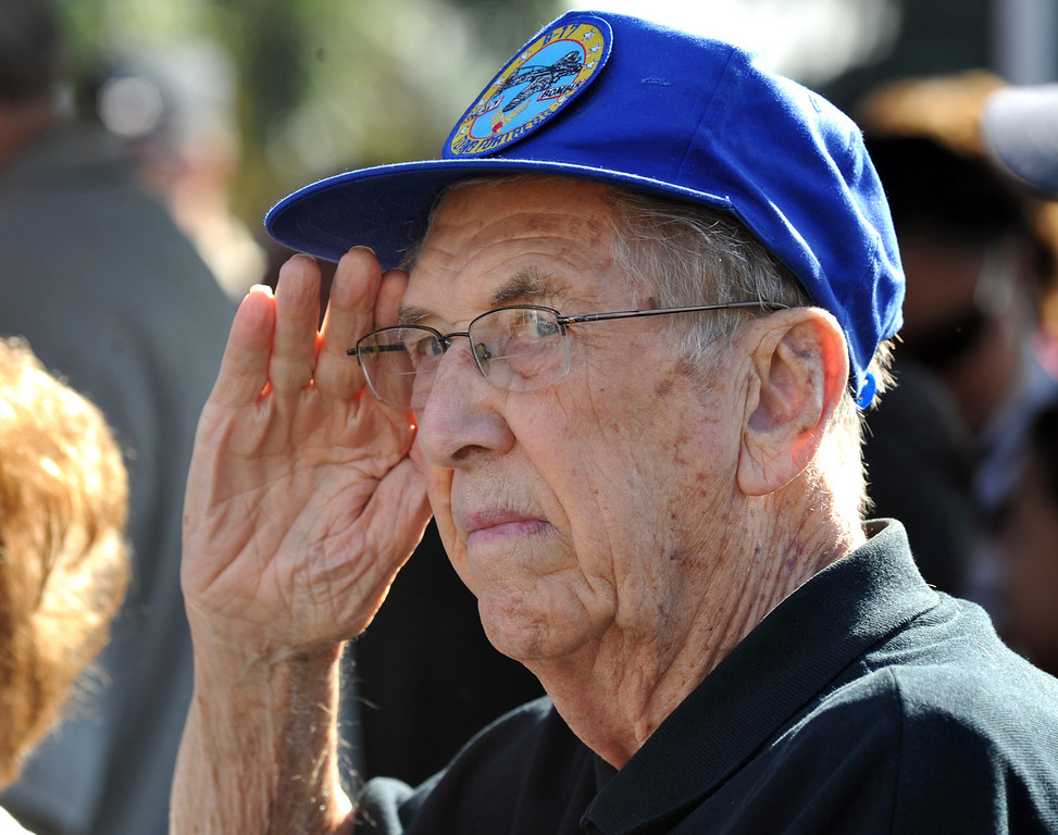 Description of . WWII veteran Chuck Neilson, who was a tail gunner on a B-17, salutes as the American flag processes during the Veterans Day Celebration at El Monte City Hall on Monday November 11, 2013. Veterans are honored with speeches and music and a flag ceremony. (San Gabriel Valley Tribune/Staff Photo by Keith Durflinger)