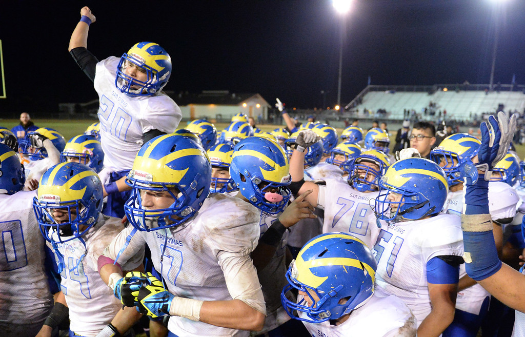 Description of . San Dimas players celebrate their win over Arroyo after their CIF Semi-Final football game at Arroyo High School in El Monte on Friday November 29, 2013. (San gabriel Valley Tribune/Staff Photo by Keith Durflinger)