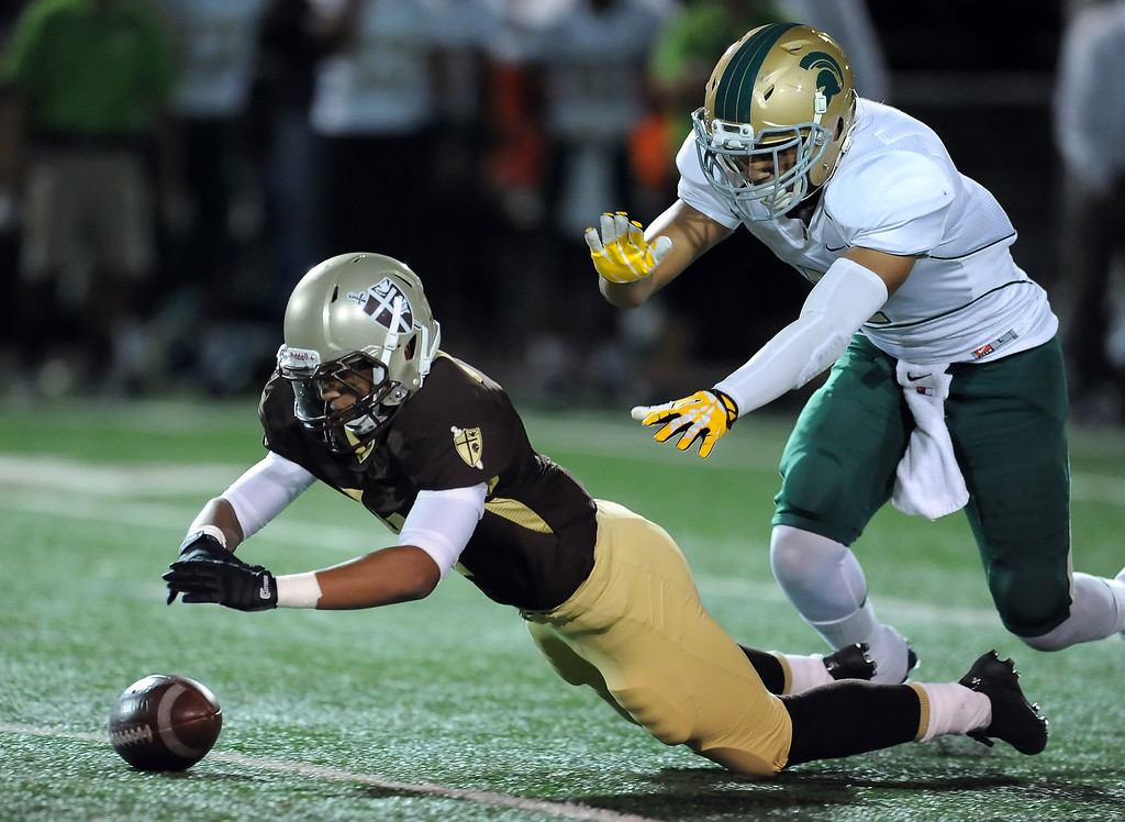 Description of . St. Francis' Mason Williams recovers a Damien fumble in the first half of a prep football game at St. Francis High School in La Canada, Calif., Friday, Sept. 27, 2013.   (Keith Birmingham Pasadena Star-News)