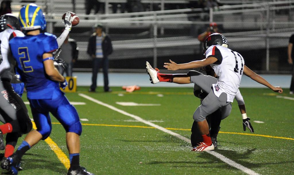 Description of . San Dimas plays Pomona in their Valley Vista League football game at San Dimas High School on November 8, 2013. San Dimas defeated Pomona 49-6. (San Gabriel Valley Tribune/Staff Photo by Keith Durflinger)