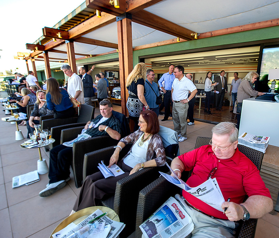 Description of . Race fans waiting for the next race, as they enjoy the newly opened, The Eddie Logan Suite at Santa Anita Park on opening of 2013 Autumn Meet.  Santa Anita Park opened with new renovations to the park, including a remodeled clubhouse along the mezzanine, outdoor seating, new sports bar and balcony Friday, September 27, 2013.(Walt Mancini/Pasadena Star-News)