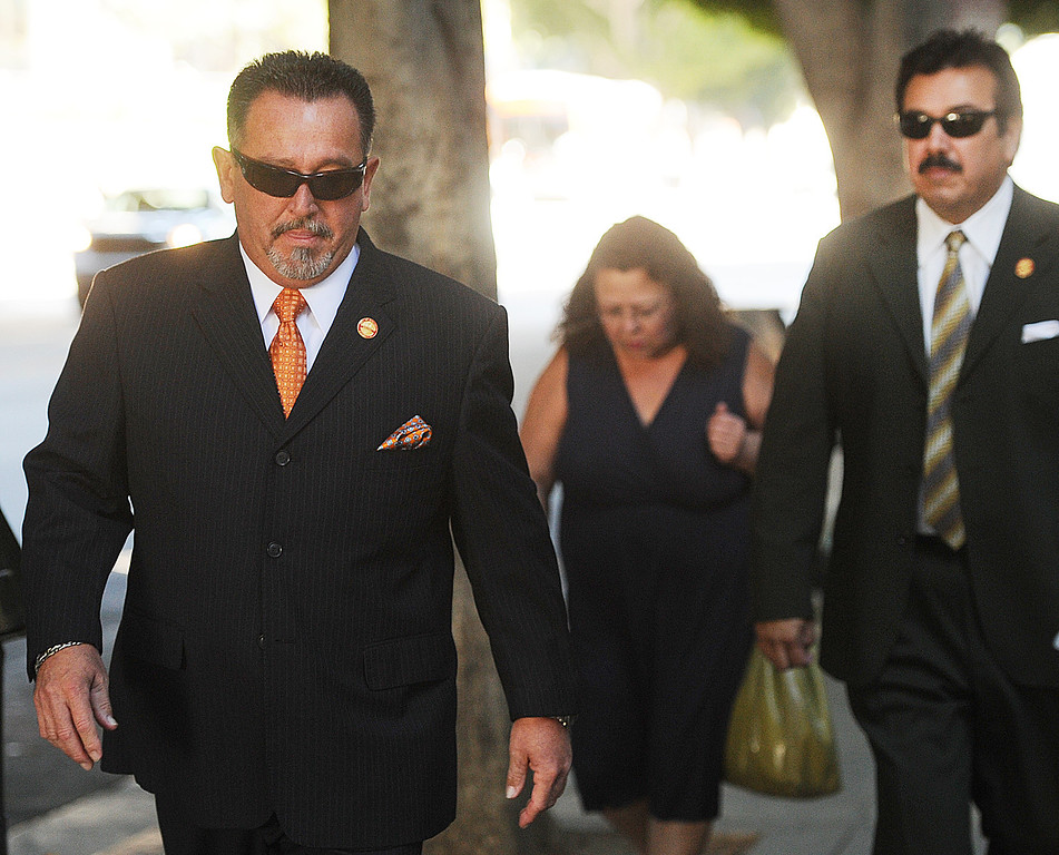 Description of . Council member Mark Breceda, left, and Manuel Garcia appeared at Clara Shortridge Foltz Criminal Justice Center in Los Angeles to scheduled a date for arraignment Wednesday, October 16, 2013.  Irwindale officials are charged with embezzlement, misappropriation of public funds and conflict of interest relating to extravagant trips taken to New York City between 2001 and 2005. Charged are City Council members Mark Breceda and Manuel Garcia and former Councilwoman Rosemary Ramirez and retired Finance Director Abe De Dios. Arraignment was delayed in September while attorneys argued charges should be dismissed due to statue of limitations. (Photo by Walt Mancini/Pasadena Star-News)b