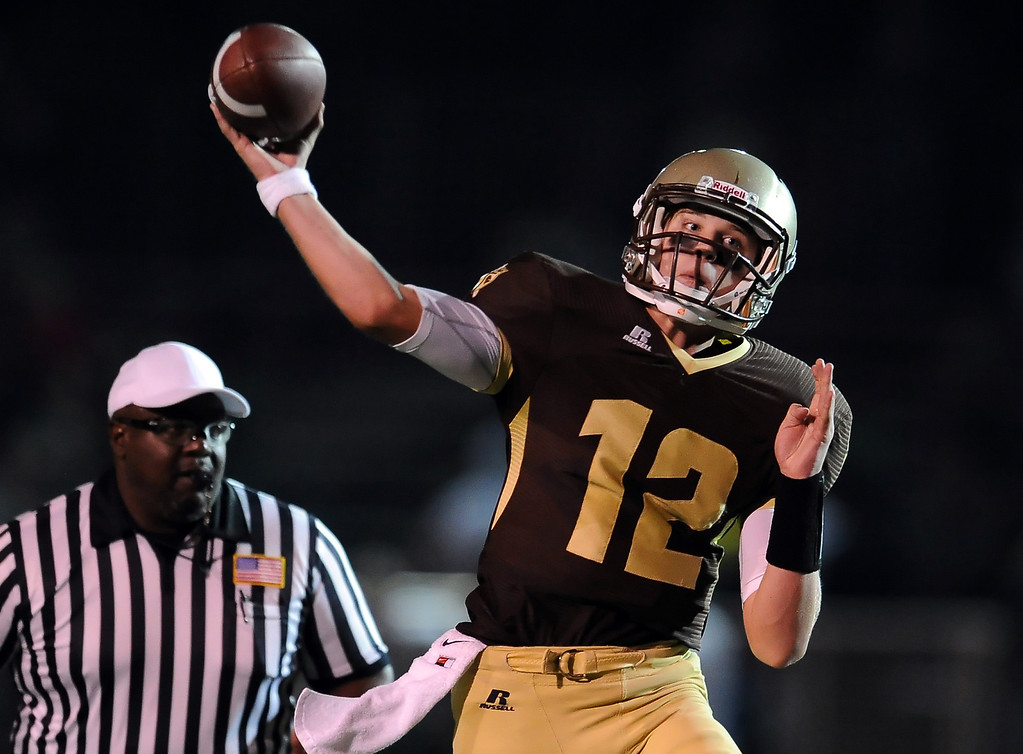 Description of . St. Francis quarterback Ty Gangi (C) passes in the first half of a prep football game against Damien at St. Francis High School in La Canada, Calif., Friday, Sept. 27, 2013.   (Keith Birmingham Pasadena Star-News)
