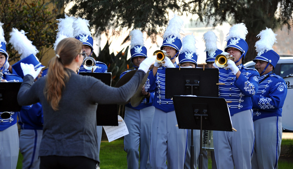 Description of . El Monte High School band plays during the Veterans Day Celebration at El Monte City Hall on Monday November 11, 2013. Veterans are honored with speeches and music and a flag ceremony. (San Gabriel Valley Tribune/Staff Photo by Keith Durflinger)