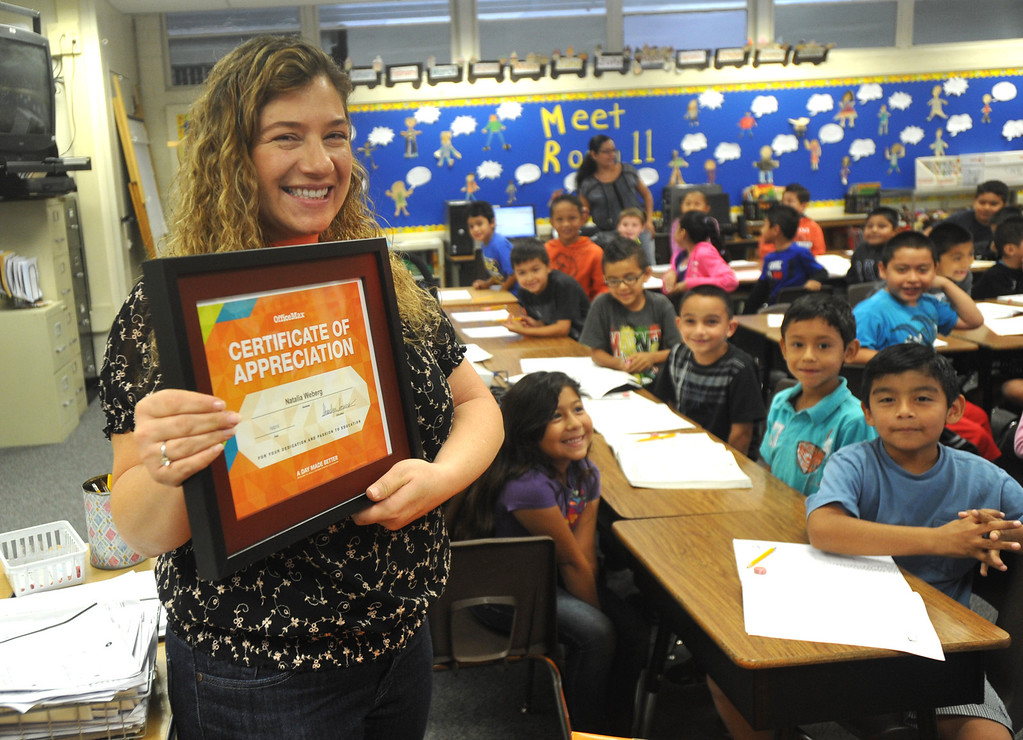 Description of . OfficeMax representatives surprise second grade teacher Natalia Weberg with $1,200 worth of classroom supplies and resources at Ceres Elementary School in Whittier on Wednesday October 2, 2013. Principal Julie Gonzalez nominated the second grade teacher for the Adopt a Classroom grant sponsored by Office Max and Adopt a Classroom. (Whittier Daily News/Staff Photo by Keith Durflinger)