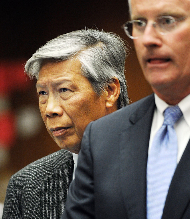 Description of . Retired Finance Director Abe De Dios, left, appeared at Clara Shortridge Foltz Criminal Justice Center in Los Angeles to scheduled a date for arraignment Wednesday, October 16, 2013.  Irwindale officials are charged with embezzlement, misappropriation of public funds and conflict of interest relating to extravagant trips taken to New York City between 2001 and 2005. Charged are City Council members Mark Breceda and Manuel Garcia and former Councilwoman Rosemary Ramirez and retired Finance Director Abe De Dios. Arraignment was delayed in September while attorneys argued charges should be dismissed due to statue of limitations. (Photo by Walt Mancini/Pasadena Star-News)b