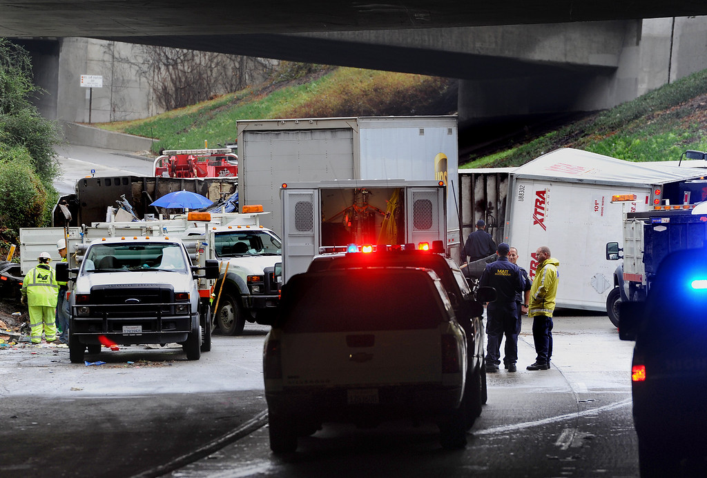 Description of . Three big-rig and two cars crashed, killing a truck driver near the runner on (210) Freeway East.  The accident at 12:01 caused the tunnel to be closed and a SigAlert was called where the tunnel was schedule to reopen by 4 to  5 p.m. Thursday, November 21, 2013. (Photo by Walt Mancini/Pasadena Star-News)