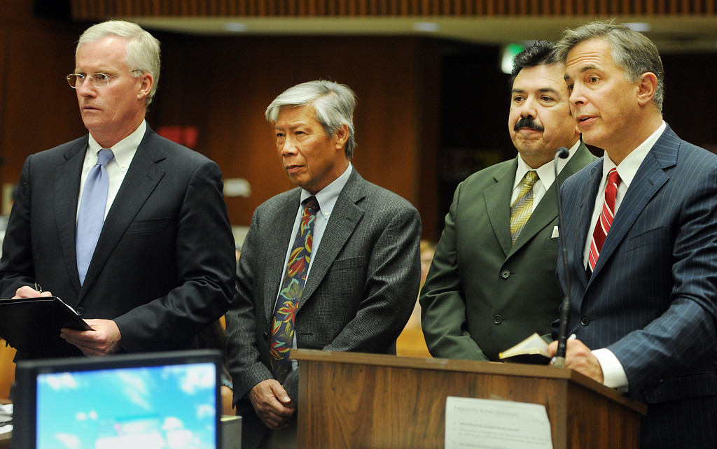 Description of . Attorney Daniel Nixon, left, Finance Director Abe De Dios, city council member, Manuel Garcia, and attorney Steven Levine appeared at Clara Shortridge Foltz Criminal Justice Center in Los Angeles to scheduled a date for arraignment Wednesday, October 16, 2013.  Irwindale officials are charged with embezzlement, misappropriation of public funds and conflict of interest relating to extravagant trips taken to New York City between 2001 and 2005. Charged are City Council members Mark Breceda and Manuel Garcia and former Councilwoman Rosemary Ramirez and retired Finance Director Abe De Dios. Arraignment was delayed in September while attorneys argued charges should be dismissed due to statue of limitations. (Photo by Walt Mancini/Pasadena Star-News)