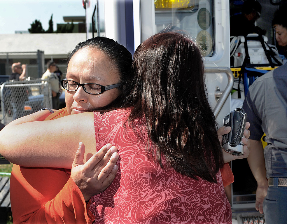 Description of . Jogina Carrillo receives a warm embrace from hospice worker after ambulance arrives her El Monte homethat brough back her six year old son, Doryan Torres. After nearly a monthlong hospitalization, Doryan Torres was released from Children's Hospital LA  Friday, October 11, 2013, and escorted home by the Sheriff's from the Hollywood hospital. Doryan has been battling Atypical Teratoid Rhabdoid Tumor (ATRT) since he was just 14 months old, a rare condition that produces rapidly reoccurring tumors in the tissues of his central nervous system(Walt Mancini/Pasadena Star-News)