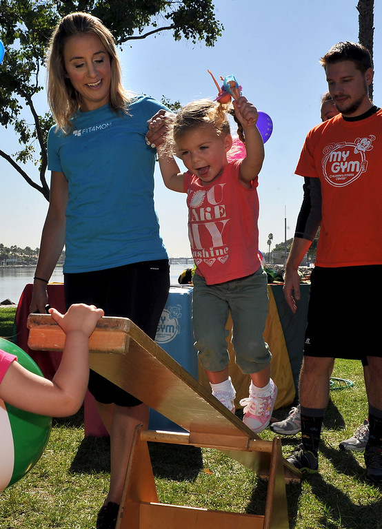 . 9/27/13 - Elizabeth Kolsky, 2, on the balancing bar during a gathering of fit moms and vendors.  Long Beach-Stroller Strides gathers moms and their children for fun outdoor exercise at Marine Stadium in Long Beach. For information on classes visit http://longbeach.fit4mom.com/ (Photo by Brittany Murray/Press Telegram)