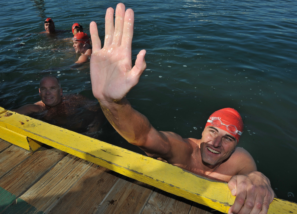 . 9/28/13 - Curtis Bowman reaches up for a hi-five from Sydney Waldrop at the dock where he and three other firefighters and two lifeguards, finished their relay swim from Catalina Island to Long Beach. At the finish they were greeted by those they raised funds for,  Jonathan Jaques Children�s Cancer Center patients and families. (Photo by Brittany Murray/Press Telegram)