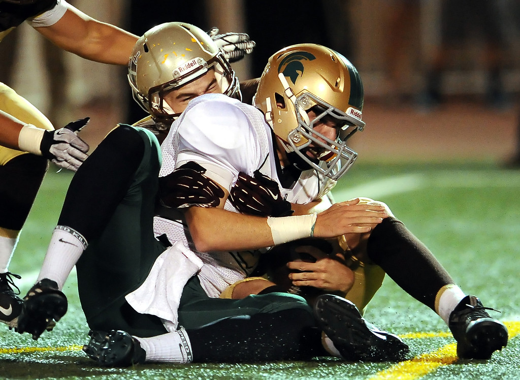 . St. Francis\' Brodie Felkel sacks Damien quarterback Brendan Callen in the first half of a prep football game at St. Francis High School in La Canada, Calif., Friday, Sept. 27, 2013.   (Keith Birmingham Pasadena Star-News)