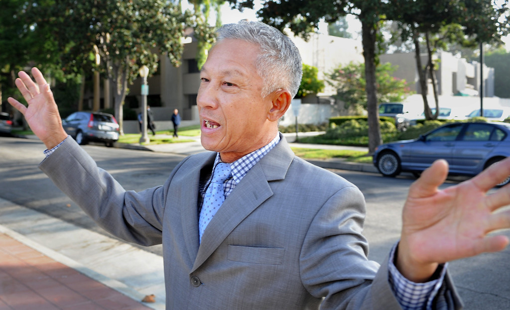 . Vinh Nguyen of Baldwin Park, believes his life will be over if he is sent back to Vietnam. About 125 Vietnamese-Americans staged a demonstration in front of the U.S. Ninth Circuit Appellate Court in Pasadena Tuesday, October 8, 2013, to request that the order of deportation issued against Vinh Nguyen, right, an Anti-Communist Hero is overturned. Nguyen violated a law, a U.S. Immigration Court on August 5, 2009, made the decision to deport him. The decision was appealed. Protesters want to seek political asylum for Nguyen, whose life, they said, will be endangered if he returns to Vietnam.(Walt Mancini/Pasadena Star-News)