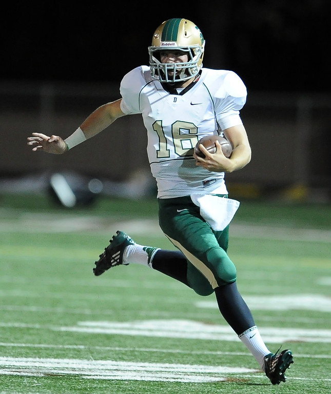 . Damien quarterback Brendan Callen (16) scrambles against St. Francis in the first half of a prep football game at St. Francis High School in La Canada, Calif., Friday, Sept. 27, 2013.   (Keith Birmingham Pasadena Star-News)