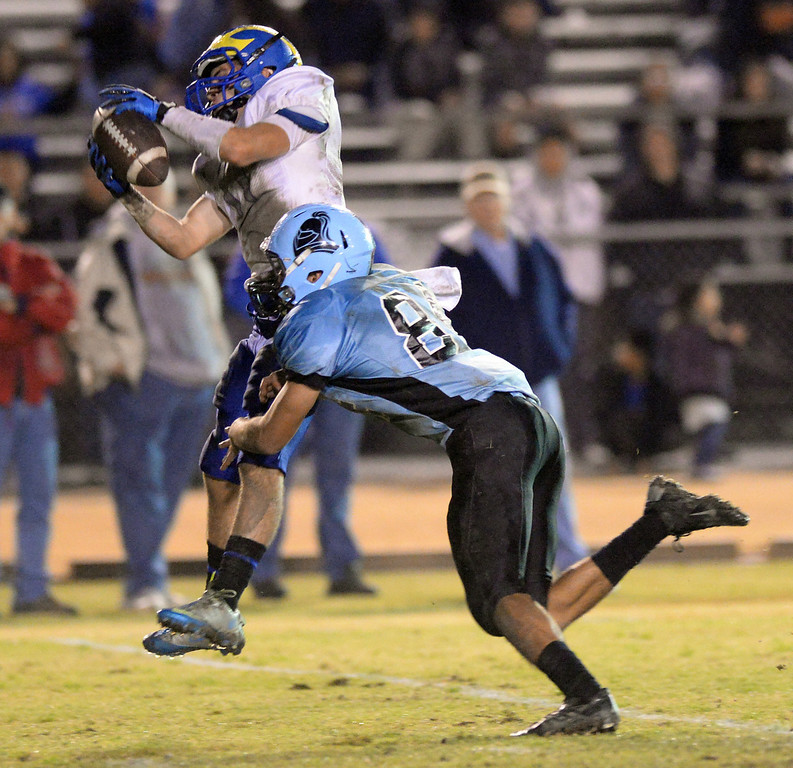 . San Dimas defensive back Erick Ware (#11) intercepts a pass as they play Arroyo in their CIF Semi-Final football game at Arroyo High School in El Monte on Friday November 29, 2013. San Dimas defeated Arroyo 61-28. (San Gabriel Valley Tribune/Staff Photo by Keith Durflinger)