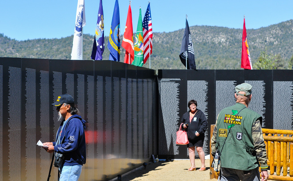 . Local veterans, family and friends of veterans visit the Traveling Vietnam Wall replica memorial at Meadow Park in Big Bear Lake on Friday, Sept. 27, 2013. The wall, presented by the American Veterans Traveling Tribute, is on display for continuous viewing from Sept. 26 through Sept. 28. (Photo by Rachel Luna / San Bernardino Sun)