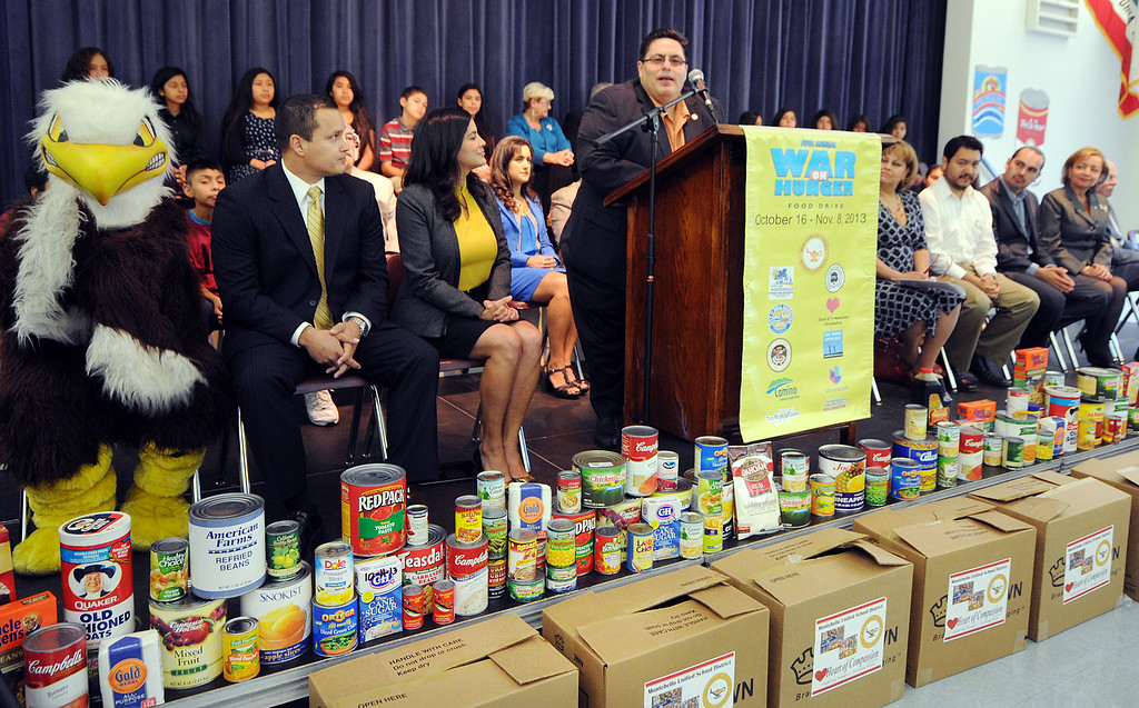 ". Board of Education President Hector Chacon, speaking on ""War On Hunger\"", food drive. The Montebello Unified School District and its partners bringing the community together to assist local families in need through its 5th Annual \""War on Hunger\"" food drive.  the District\'s Kick-Off Event was held at Montebello Intermediate School Wednesday, October 16, 21013. (Photos by Walt Mancini/Pasadena Star-News)"