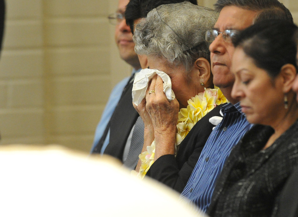 . Celia Jimenez wipes away tears during the funeral service for her husban, Mario, owner of Mario\'s Taco\'s, at St. Hillary\'s Catholic Church in Pico Rivera on Tuesday October 15, 2013. Jimenez who had been an active member of the community and hosted their free Thanksgiving dinners, died Wednesday October 8th after a long battle with cancer. (Whittier Daily News/Staff Photo by Keith Durflinger)