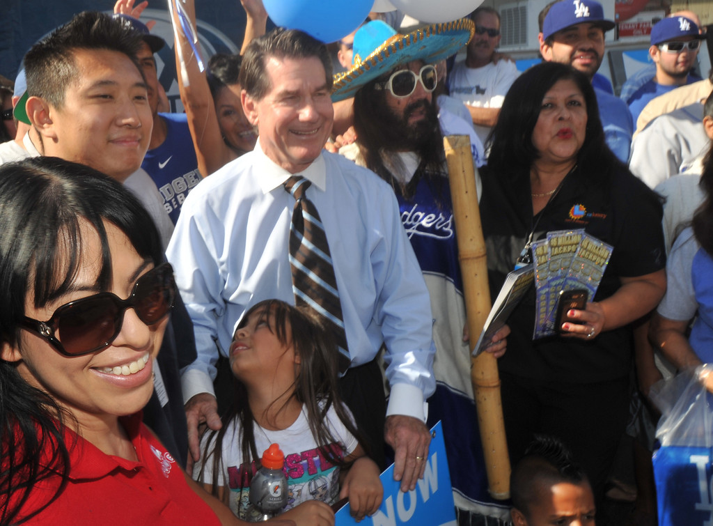 . Former Dodgers first baseman Steve Garvey poses with fans during a promotion for the California State Lottery\'s new $5M scratchers at the Barley Bin Liquor Store in Whittier on Wednesday October 2, 2013. Fans lined up around the parking lot to get Garvey\'s autograph. (Whittier Daily News/Staff Photo by Keith Durflinger)