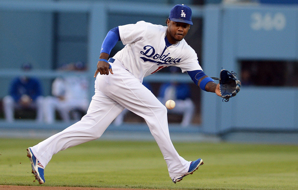 . The Dodgers\' Hanley Ramirez #13 makes the stop on Rockies\'  Charlie Culberson #23 ground ball during their game at Dodgers Stadium Saturday, September 28, 2013. (Photo by Hans Gutknecht/Los Angeles Daily News)