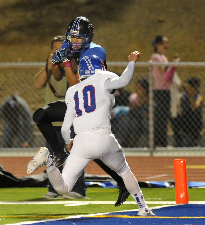. Diamond Ranch receiver Daniel Garcia (#3) catchs a pass for a touchdown as they play Los Altos in their Hacienda League opener football game at Diamond Ranch High School in Pomona on Friday October 4, 2013. (San Gabriel Valley Tribune/Staff Photo by Keith Durflinger)