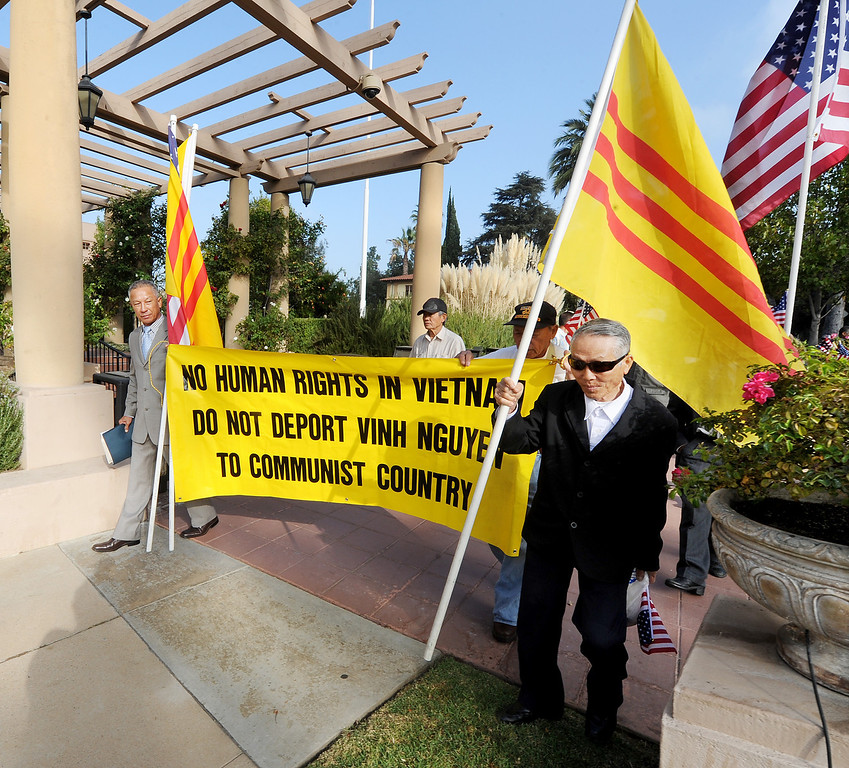 . Vinh Nguyen, leading a demonstration with about 125 Vietnamese-Americans, who staged a demonstration in front of the U.S. Ninth Circuit Appellate Court in Pasadena Tuesday, October 8, 2013, to request that the order of deportation issued against Vinh Nguyen, an Anti-Communist Hero is overturned. Nguyen violated a law, a U.S. Immigration Court on August 5, 2009, made the decision to deport him. The decision was appealed. Protesters want to seek political asylum for Nguyen, whose life, they said, will be endangered if he returns to Vietnam.(Walt Mancini/Pasadena Star-News)