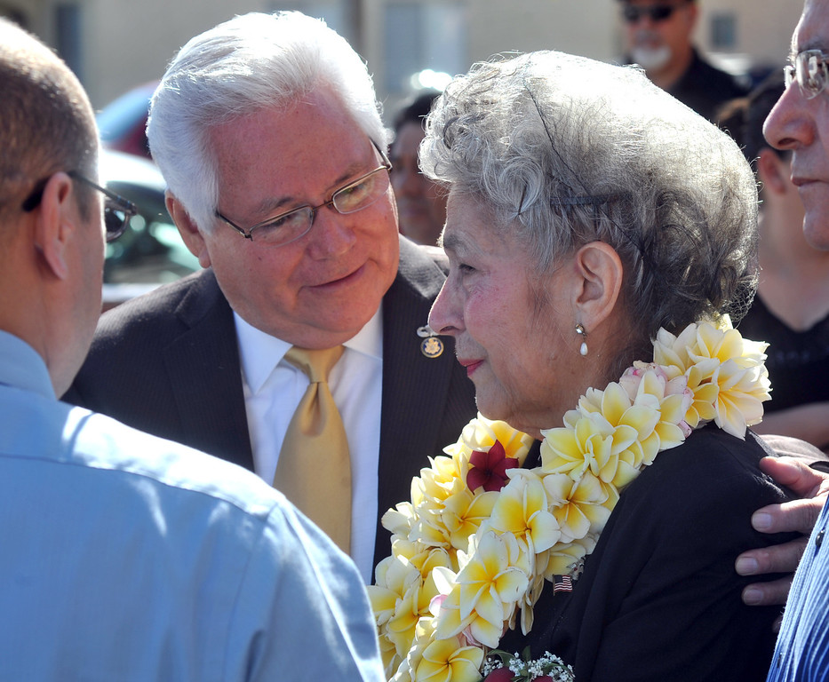 . Pico Rivera City Councilmember Bob Archuletta consoles Celia Jimenez after the funeral service for her husband, Mario Jimenez, owner of Mario\'s Taco\'s, at St. Hillary\'s Catholic Church in Pico Rivera on Tuesday October 15, 2013. Jimenez who had been an active member of the community and hosted their free Thanksgiving dinners, died Wednesday October 8th after a long battle with cancer. (Whittier Daily News/Staff Photo by Keith Durflinger)